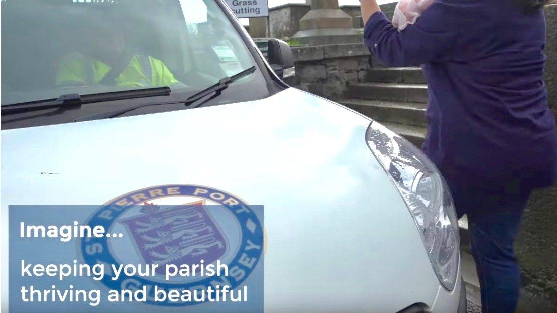Photo of Douzenier passing a white van with a St Peter Port parish logo